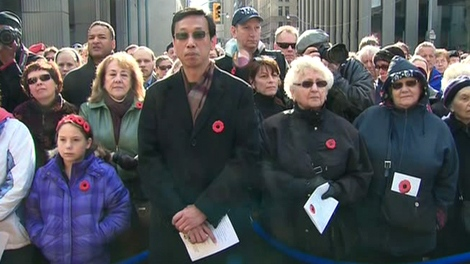 Thousands of Canadians gather at Old City in downtown Toronto to observe a moment of silence on Remembrance Day, Wednesday, Nov. 11, 2009.