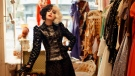 """This image released by Disney shows Emma Stone in a scene from """"Cruella."""" (Disney via AP)"""