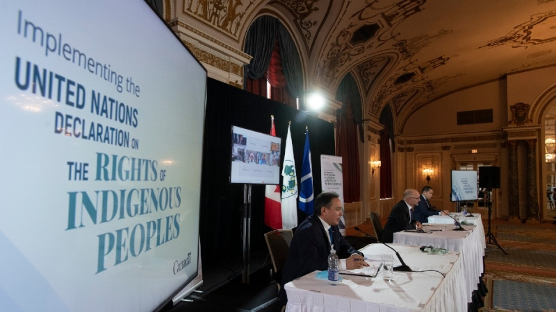 Assembly of First Nations Chief Perry Bellegarde, left to right, Justice Minister David Lametti and President of the Inuit Tapiriit Kanatami Natan Obed participate in an announcement about the United Nations Declaration on the Rights of Indigenous Peoples, in Ottawa, on Dec. 3, 2020. (Adrian Wyld / THE CANADIAN PRESS)