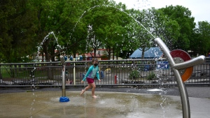 Lexie F., 7, plays at a splash pad in Ottawa, Friday, May 21, 2021. The City of Ottawa opened splash pad facilities earlier in the week as temperatures are expected to reach 30C on Friday, but the province's phased reopening plan does not permit them to open until Ontario enters Step 1 in June. (Justin Tang/THE CANADIAN PRESS)