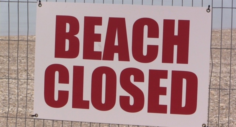 A 'Beach Closed' sign is seen in Goderich, Ont. on Friday, May 21, 2021. (Scott Miller / CTV News)
