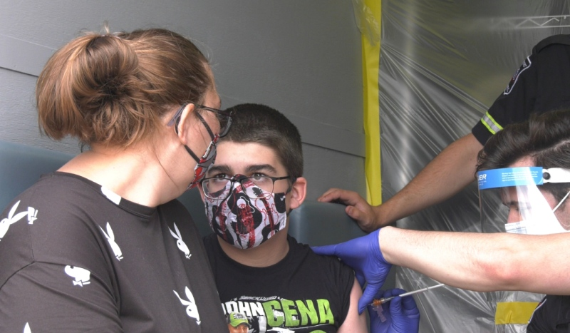 L.J. Lajoie, 12, attended the walk-in clinic held in the parking lot of the Food Basics grocery store in Timmins on Friday. He received his first dose of the Pfizer vaccine. (Lydia Chubak/CTV News)