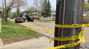 Police tape ropes off the scene of a fatal collision involving a pedestrian and a vehicle in the area of 129 Avenue and 126 Street Friday afternoon. May 21, 2021 (CTV News Edmonton/ Brandon Lynch)