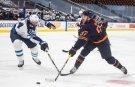 Edmonton Oilers' Connor McDavid (97) gets the shot away as Winnipeg Jets' Derek Forbort (24) defends during second period NHL Stanley Cup playoff action in Edmonton on Friday, May 21, 2021.THE CANADIAN PRESS/Jason Franson