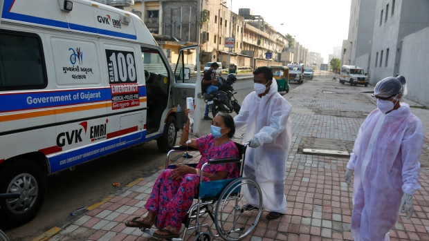 Paramedics shift a patient infected with black fungus to Mucormycosis ward of a government hospital in Ahmedabad, India, Friday, May 21, 2021. India's confirmed coronavirus cases and deaths remained below record levels in the last 24 hours, but authorities are worried about fungal infection that attacks those with weak immune systems. (AP Photo/Ajit Solanki)