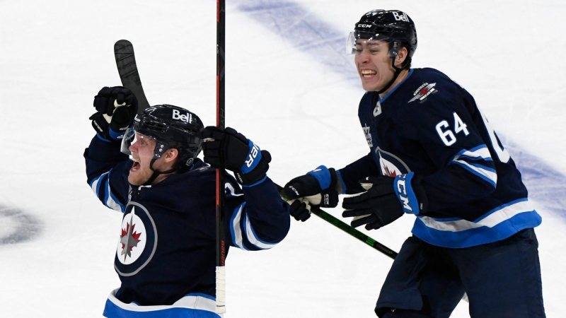 Winnipeg Jets' Nikolaj Ehlers (27) celebrates his game-winning goal with teammate Logan Stanley (64) in the first overtime period during NHL Stanley Cup playoff action against the Edmonton Oilers, in Winnipeg on Sunday, May 23, 2021. (THE CANADIAN PRESS/Fred Greenslade)