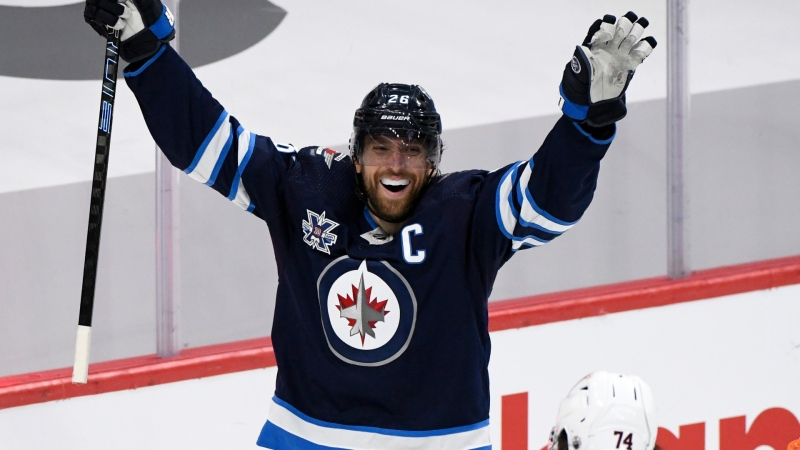 Winnipeg Jets' Blake Wheeler (26) celebrates a goal by Mark Scheifele during third period NHL Stanley Cup playoff action against the Edmonton Oilers, in Winnipeg on Monday, May 24, 2021. (THE CANADIAN PRESS/Fred Greenslade)