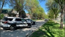 Police vehicles hold a scene as part of an investigation underway Tuesday morning on Manitoba Ave. in Winnipeg (Photo: Gary Robson/CTV News)
