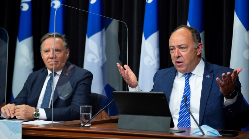 Quebec Health Minister Christian Dube, right, responds to reporters questions during a news conference on the COVID-19 pandemic, Tuesday, May 25, 2021 at the legislature in Quebec City. Quebec Premier Francois Legault, left, looks on. THE CANADIAN PRESS/Jacques Boissinot