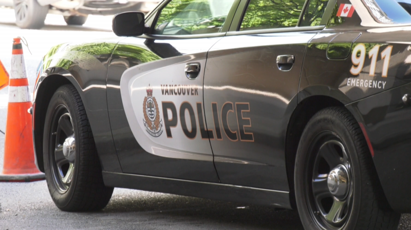 A police cruiser is parked outside a Vancouver courthouse on Tuesday, May 26, 2021.