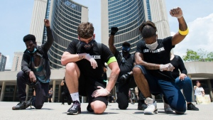 People protest in solidarity with the George Floyd protests and honouring black lives that have been lost at the hands of police across the United States in Toronto on Friday, June 5, 2020. THE CANADIAN PRESS/Nathan Denette