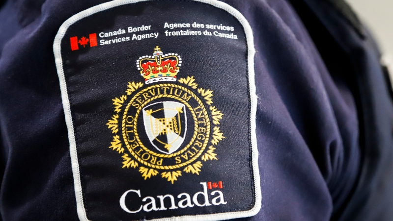 A Canada Border Services Agency patch is seen on an officer in Calgary, Alta., Thursday, Aug. 1, 2019. (THE CANADIAN PRESS / Jeff McIntosh)