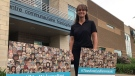 Tanya Tamilio of the Centre communautaire francophone stands by new lawn signs welcoming newcomers to Sarnia, Ont. on May 26, 2021. (Sean Irvine/CTV London)