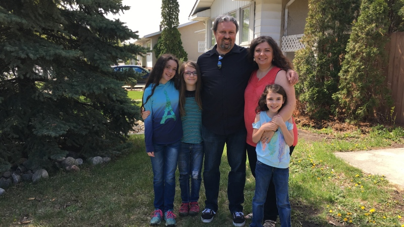 The McDougall family poses in their front yard. (Taylor Rattray/CTV Regina)