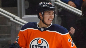 Edmonton Oilers' Ethan Bear (74) celebrates his first NHL goal against the Anaheim Ducks during third period NHL action in Edmonton, Alta., on Sunday, March 25, 2018. THE CANADIAN PRESS/Jason Franson