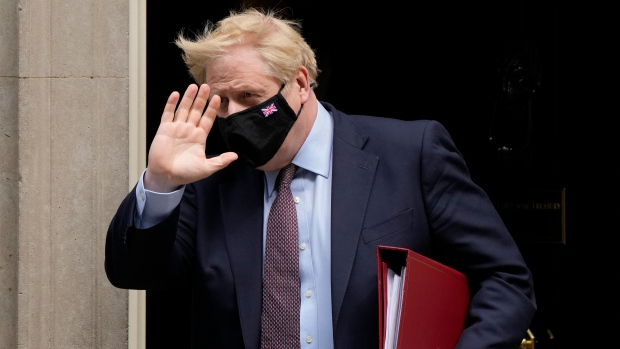 Britain's Prime Minister Boris Johnson leaves 10 Downing Street to attend the weekly Prime Ministers' Questions session in parliament in London, Wednesday, May 26, 2021. (AP Photo/Frank Augstein)