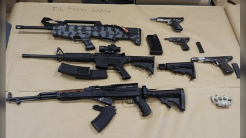 A picture of the loaded guns allegedly found in a South Surrey home by the Surrey RCMP drug unit on May 19, 2021 (Surrey RCMP)
