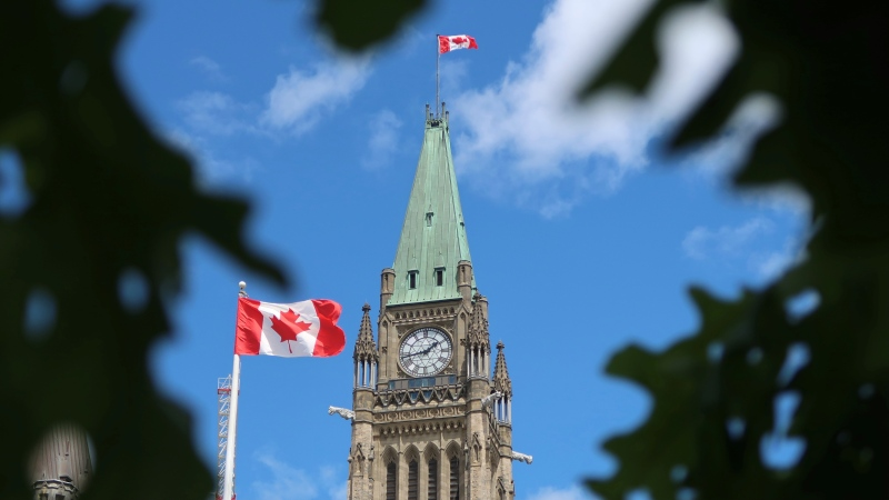The Peace Tower and a Canadian Flag are seen in this photo taken on May 27, 2021. (Photo by CTV News' Jeff Denesyk)