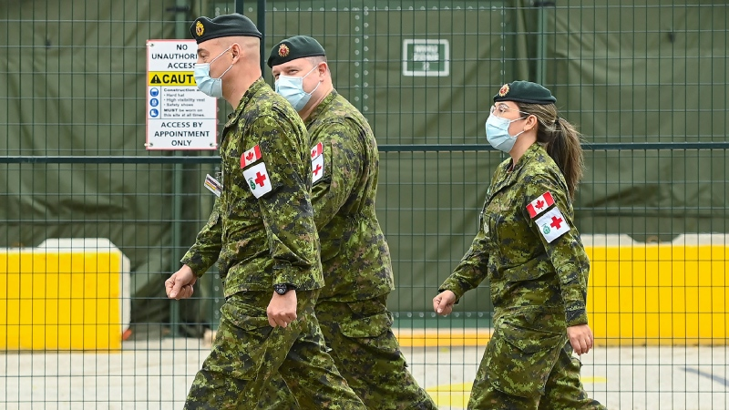 Military health-care personnel are on site at a mobile health unit at Sunnybrook Hospital during the COVID-19 pandemic in Toronto on Friday, April 30, 2021. THE CANADIAN PRESS/Nathan Denette