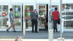 Customers enter Les Promenades shopping centre in Gatineau.