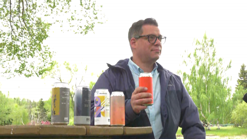"""At precisely 11 a.m. on May 28, 2021, Ward 3 Coun. Jon Dziadyk cracked a cold one -- a crisp lager named """"Clock Out"""" by Edmonton brewer SYC -- in Rundle Park and took a swig. A pilot program allowing alcohol consumption at designated park sites between 11 a.m. and 9 p.m. will run until Oct. 11, 2021."""
