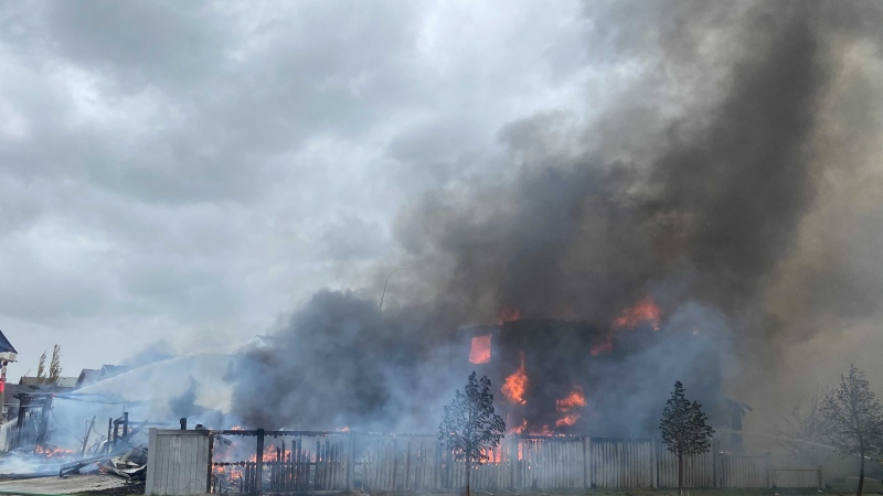 Firefighters battle flames at a fire in north Edmonton Friday afternoon that has affected multiple homes (Courtesy Cody Collison)