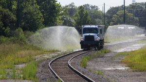 A spray truck is seen misting railroad tracks in an image posted to the B.C. Conservation Officer Service Facebook page.