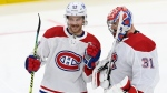 Montreal Canadiens defenceman Jon Merrill (28) and Carey Price (31) celebrate their win over the Toronto Maple Leafs after overtime NHL Stanley Cup playoff action in Toronto on Thursday, May 27, 2021. THE CANADIAN PRESS/Frank Gunn