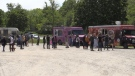 People lined up at the food trucks parked at the kayak launch at Wonderland Road and Riverside Drive on Saturday May 29, 2021 (Bryan Bicknell / CTV News)