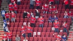 Fans cheer on their teams at the Bell Centre during first period NHL Stanley Cup playoff hockey action between the Montreal Canadiens and Toronto Maple Leafs in Montreal, Saturday, May 29, 2021. THE CANADIAN PRESS/Graham Hughes