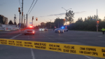 Ottawa police tape at the intersection of Woodroffe Avenue and Baseline Road after a shooting. May 30, 2021. (Aaron Reid/CTV News Ottawa)