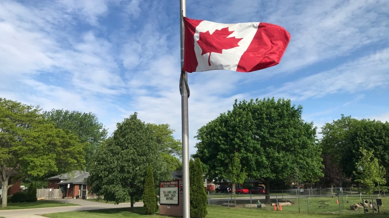 A Canadian flag flys at half mast outside Sir Issac Brock Public School (Sean Irvine CTV News)