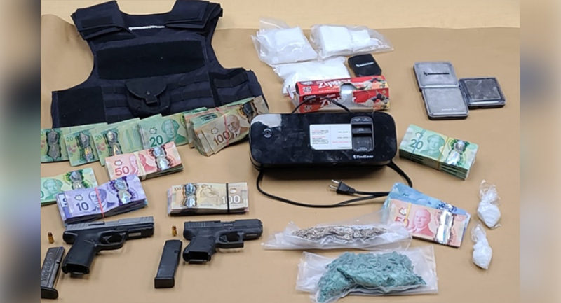 Guns, drugs and cash were seized in London, Ont. on Sunday, May 30, 2021. (Source: London Police Service)