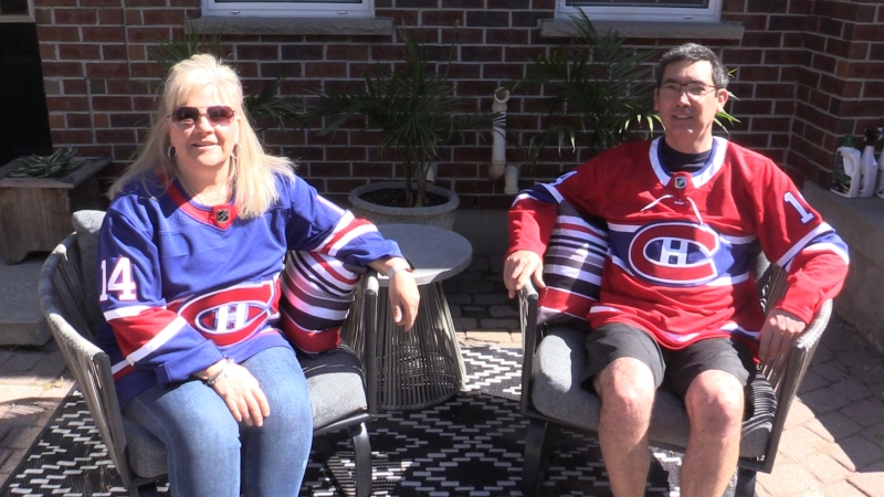 Amanda and Rob Suzuki, parents of Montreal Canadiens forward Nick Suzuki, show off their jerseys on Monday, May 31, 2021. (Brent Lale / CTV News)