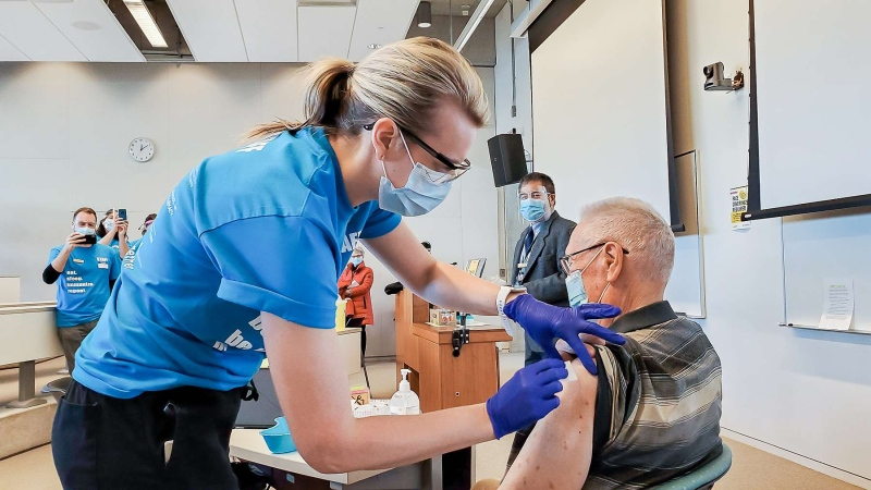 Staff administer a Pfizer vaccine at the Health Sciences Clinic in Kitchener (Supplied: University of Waterloo)
