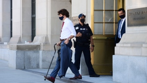 Prime Minister Justin Trudeau walks with a cane as he leaves a news conference in Ottawa on Monday, May 31, 2021. THE CANADIAN PRESS/Sean Kilpatrick