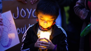 Joyce Echaquan's son, Lucas attends a vigil in front of the hospital where his mother died in Joliette, Que. on Tuesday, September 29, 2020. A nurse has been fired after Echaquan, an Indigenous woman, who was dying Monday night in hospital was subjected to degrading remarks. THE CANADIAN PRESS/Paul Chiasson