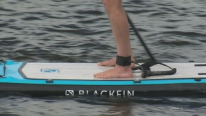 Paddleboarding fun on St. Charles Lake in Sudbury