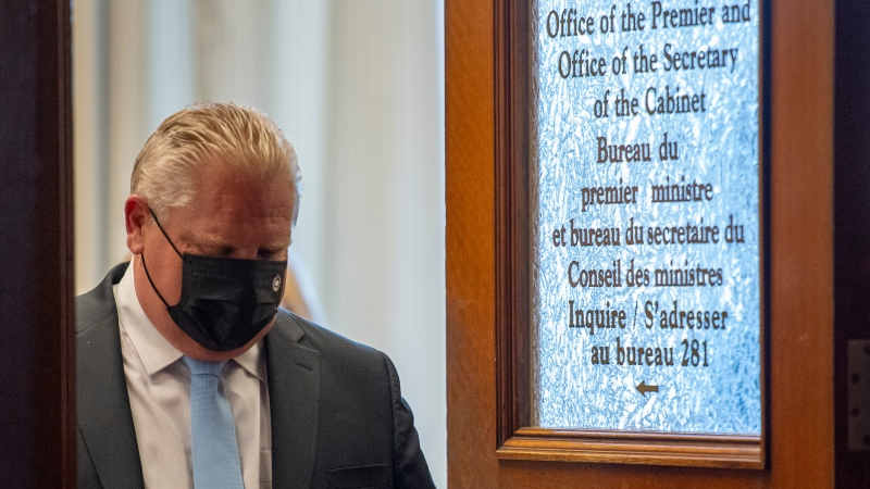 """Ontario Premier Doug Ford leaves his office for a press conference at the Ontario Legislature in Toronto, Thursday, May 13, 2021. Ontario is extending its stay-at-home order until June 2 to bring down high rates of COVID-19, a move Premier Doug Ford said was necessary to bring infection cases down and """"save the summer."""" THE CANADIAN PRESS/Frank Gunn"""