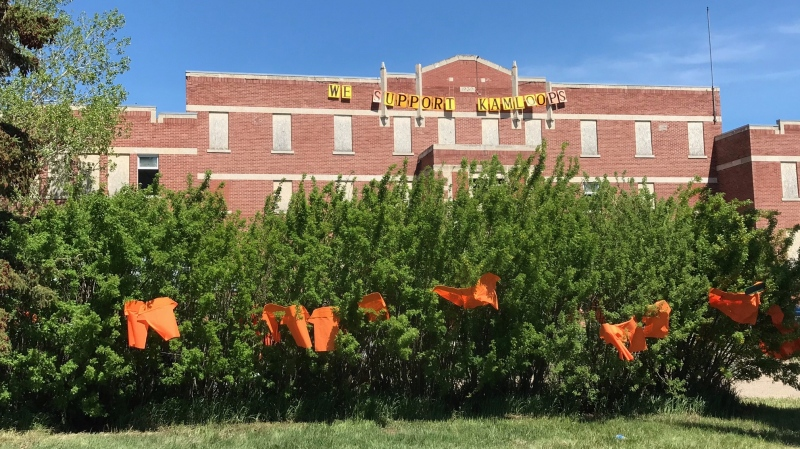 """A sign that reads """"We Support Kamloops"""" hangs on the front of the Muscowequan Indian Residential School, the last residential school to close its doors in Saskatchewan in 1997. (Stefanie Davis/CTV Regina)"""