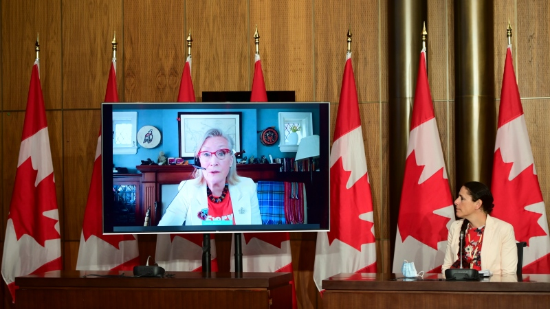 Carolyn Bennett, Minister of Crown-Indigenous Relations, speaks virtually as Valerie Gideon, Associate Deputy Minister of Indigenous Services Canada, loos on during a press conference in Ottawa on Wednesday, June 2, 2021. THE CANADIAN PRESS/Sean Kilpatrick