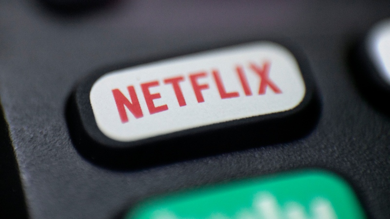 This Aug. 13, 2020 file photo shows a logo for Netflix on a remote control in Portland, Ore. (AP Photo/Jenny Kane, File)