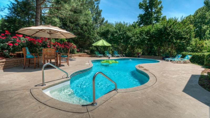 Backyard swimming pool. (Zack Rogge/DREAMSTIME)