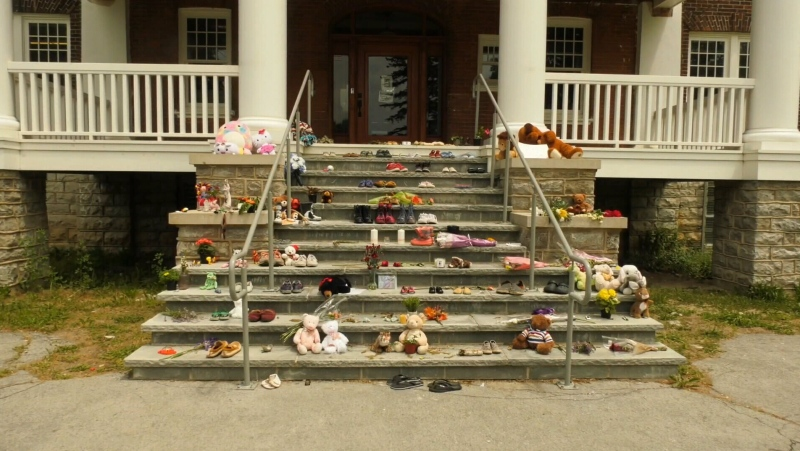 A growing memorial at the site of former Mohawk Institute Residential School in Brantford, Ont.