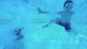A child swims in a pool. (Pat Foran/CTV NEWS TORONTO)