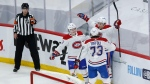 Montreal Canadiens' Nick Suzuki (14) celebrates his goal with teammates Cole Caufield (22), and Tyler Toffoli (73) during first period NHL Stanley Cup playoff hockey action against the Winnipeg Jets, in Winnipeg, Wednesday, June 2, 2021. THE CANADIAN PRESS
