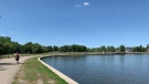 A man walks around Wascana lake, taking advantage of the 30+ degree weather in Regina during a June heat wave. (Colton Wiens/CTV News)