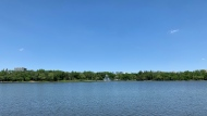 Very few clouds were in the sky over Regina's Wascana Lake, as temperature rose over 30 degrees during a heat wave in June 2021. (Colton Wiens/CTV News)
