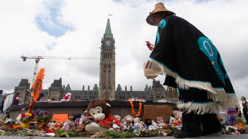 Wiit tisim hanakum skaaqkw dances around the Centennial flame during a ceremony on Parliament Hill Thursday June 3, 2021 in Ottawa. THE CANADIAN PRESS/Adrian Wyld