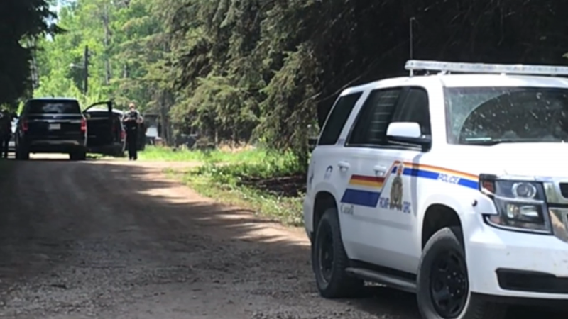 RCMP prevent access to a home in the Buck Lake, Alta., area on June 2, 2021, after a fire which killed two children.